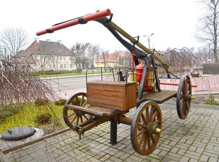 Ancient fire pomp on horse draft. Poland, Kentshin