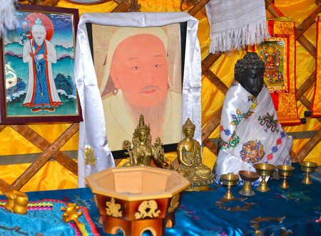 ELISTA, RUSSIA - APRIL 22, 2017: Genghis Khans portrait and objects of a Buddhist cult in the Kalmyk yurta Editorial