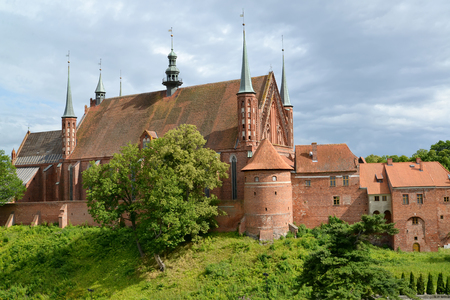 View of the Cathedral of Rise of Blessed Virgin of Maria and the Saint apostle Andrew the First-Called behind a fortification. Frombork, Poland Stock Photo
