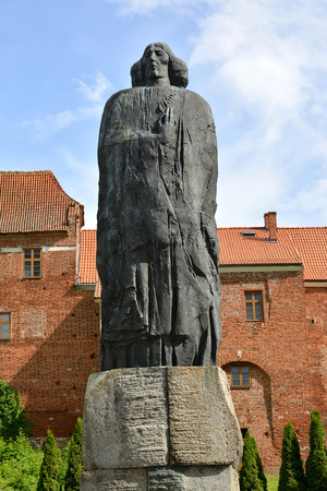 FROMBORK, POLAND - JULY 09, 2015: A monument to Nicolaus Copernicus against the background of historical buildings