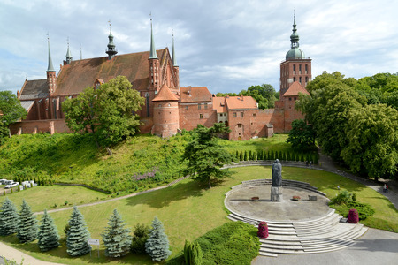 View of a cathedral complex and the area with a monument to Nicolaus Copernicus. Frombork, Poland