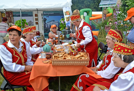 Participants of the Belarusian national folklore ensemble have tea on an agricultural holiday