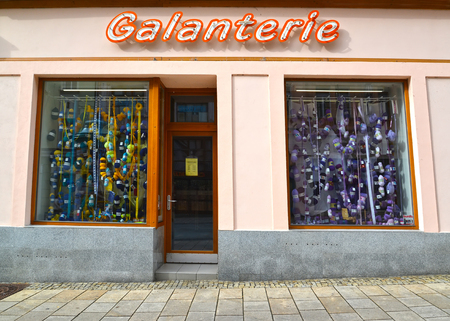 KARLOVY VARY, CZECH REPUBLIC - MAY 27, 2014: Show-window and sign of Galanterie shop. Czech text Haberdashery