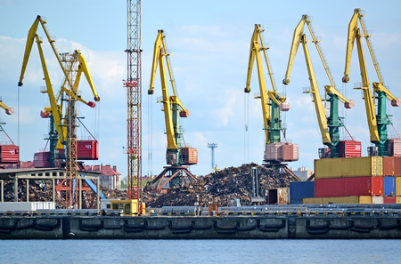 Port easels on scrap metal loading. Kaliningrad trade seaport