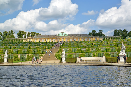 POTSDAM, GERMANY - AUGUST 14, 2017: A view of grape terraces and Frederick the Greats palace in the Sanssousi park