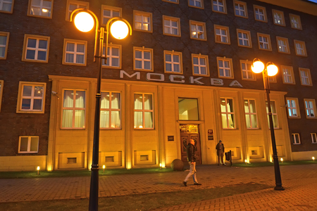 KALININGRAD, RUSSIA - DECEMBER 17, 2016: Facade of Moscow hotel in the evening. The Russian text on the building Moscow Editorial