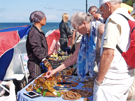 SVETLOGORSK, RUSSIA - AUGUST 23, 2009: Sale of amber souvenirs on a promenade