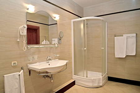 Bathroom interior with a shower booth and a sink
