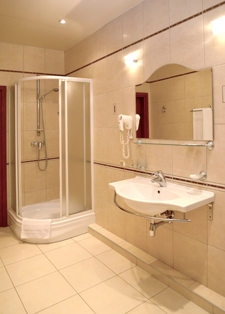 Bathroom interior fragment with a shower booth and a sink 写真素材