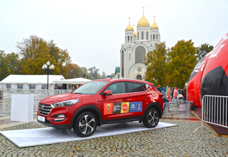 KALININGRAD, RUSSIA - OCTOBER 14, 2017: The car of Hyundai with symbolics of the FIFA World Cup of FIFA 2018 in Russia against the background of Christ the Saviour Cathedral Editorial
