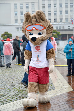 KALININGRAD, RUSSIA - OCTOBER 14, 2017: Animator in a suit of a mascot of the FIFA World Cup FIFA 2018 of a wolf cub Zabivaki