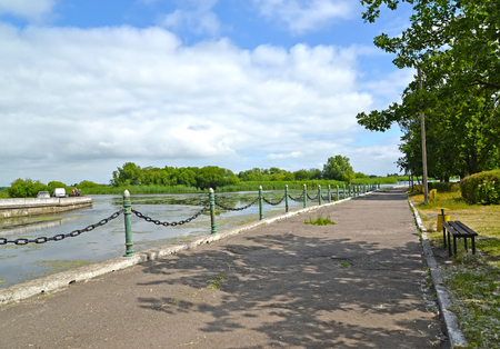 Deyma River Embankment in the summer afternoon. Polessk, Kaliningrad region Stock Photo - 99281539