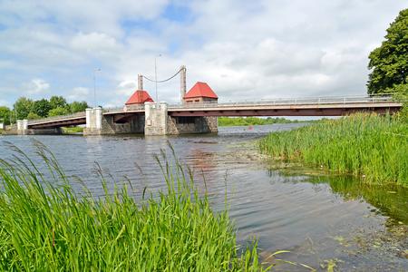 The eagle movable bridge through the Deyma River. Polessk, Kaliningrad region