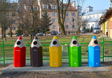 LIDZBARK-VARMINSKI, POLAND - MARCH 25, 2018: Garbage containers in the form of colored pencils. The Polish text - the paper, glass, plastic, bio, different Editorial
