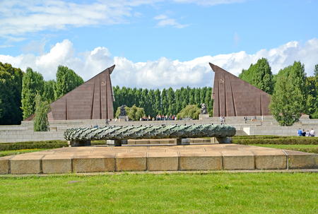 BERLIN, GERMANY - AUGUST 13, 2017: A bowl for fire against the background of the portal in the form of granite banners. The Soviet military memorial in Treptov-parke