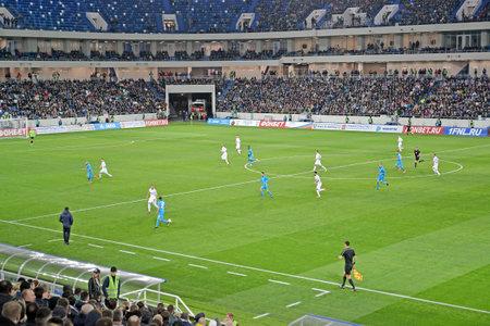 KALININGRAD, RUSSIA - APRIL 11, 2018: Players of the soccer teams Baltika - Krylja Sovetov in the field of Baltic Arena stadium