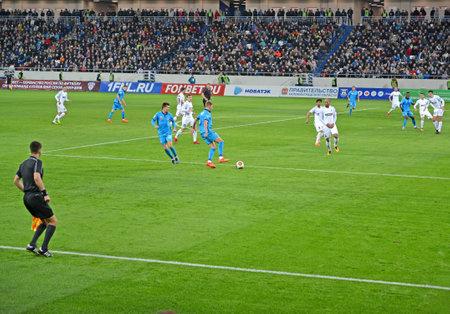 KALININGRAD, RUSSIA - APRIL 11, 2018: The game moment in a football match of the Baltika teams - Krylja Sovetov. Baltic Arena stadium