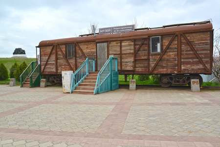 ELISTA, RUSSIA - APRIL 21, 2017: Memorial complex Outcome and Return. Car museum of Stalin deportation of Kalmyks. The Russian text - the Museum of deportation