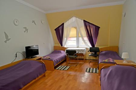 Interior of the quadruple hotel room in violet tones