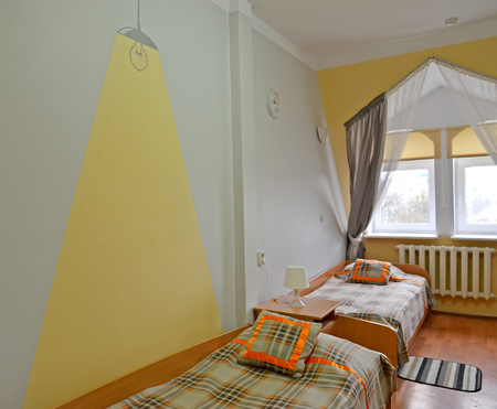 Fragment of an interior of the double hotel room in hostel