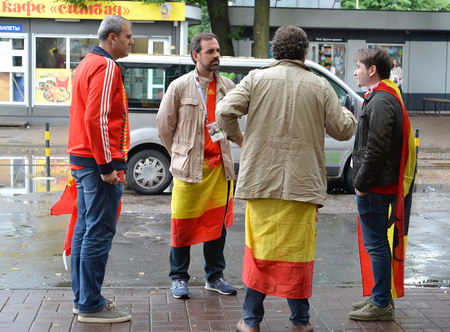 KALININGRAD, RUSSIA - JUNE 22, 2018: Fans of national team of Spain stand on the street. The FIFA World Cup in Russia