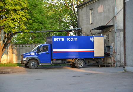 CHERNYAKHOVSK, RUSSIA - APRIL 29, 2018: The Russian Post  truck costs on unloading of mailings in post office.