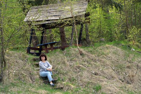 The woman sits on the steps of the tourist parking. Kaliningrad region Stock Photo