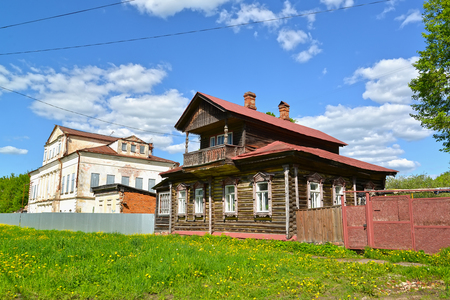 Wooden house with the mezzanine and the stone mansion of the 19th century. Uglich, Yaroslavl region Editoriali