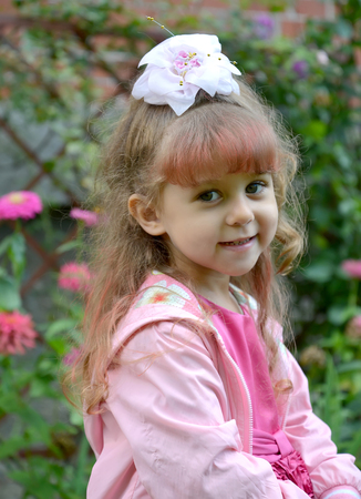 Portrait of the four-year-old girl in pink clothes
