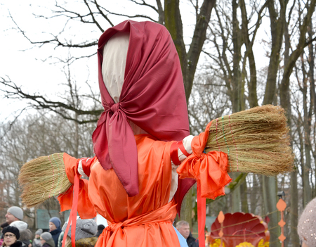 KALININGRAD, RUSSIA - FEBRUARY 18, 2018: Maslenitsa effigy with brooms instead of hands. A holiday in the park