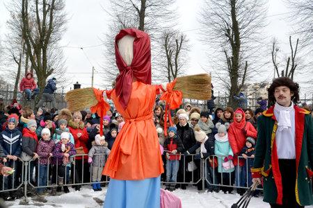 KALININGRAD, RUSSIA - FEBRUARY 18, 2018: People stand around Maslenitsa effigy in the city park Editöryel