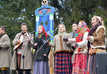 KALININGRAD, RUSSIA - FEBRUARY 18, 2018: Performers of amateur ensemble speak in the park at the celebration of Maslenitsa