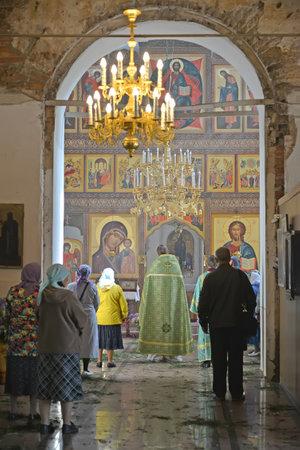 The believers people stand on church service in Church of the Assumption. Poshekhonje, Yaroslavl region