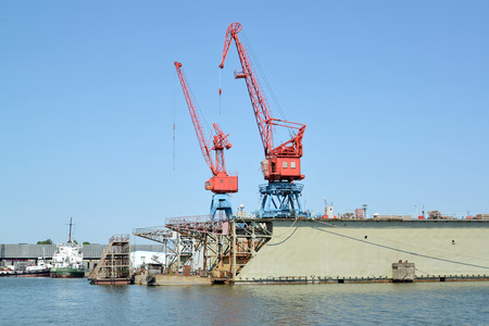Fragment of ship dock with port cranes. City Svetlyj, Kaliningrad region