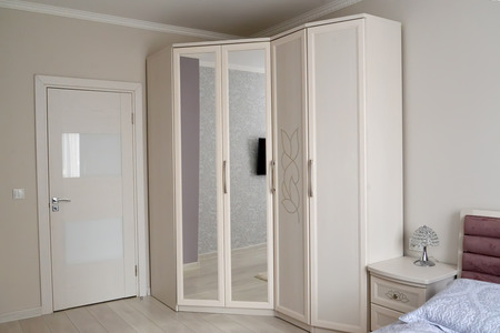White wardrobe in a bedroom interior. Scandinavian style