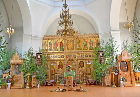 Iconostasis and church furniture of the temple of the Iverian Theotokos on the Trinity Sunday. Rybinsk, Yaroslavl region