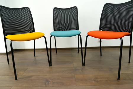 Three color office chairs stand indoors 版權商用圖片