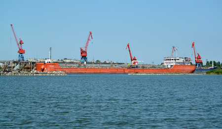KALININGRAD REGION, RUSSIA - JULY 15, 2018: The Lada bulk carrier against the background of seaport