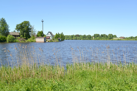 Buildings on the river bank of Pertomki. Poshekhonje, Yaroslavl region