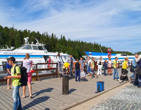 KARELIA, RUSSIA - JULY 12, 2012: Tourists stand on pier of Valaam Monastery