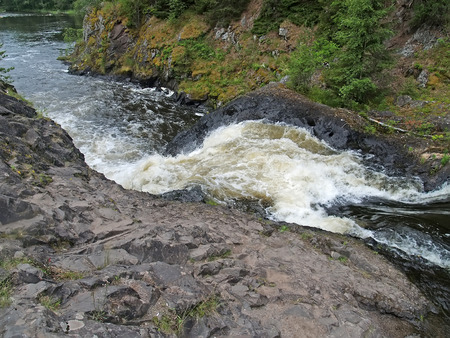 The raging falls on the Suna River in summer day. Karelia, Kivach