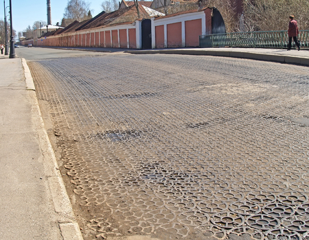 A pig-iron pavement on the street of Kronstadt Stock Photo