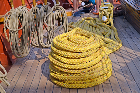 The ship rope turned into the bay lies on the deck of the sailing vessel