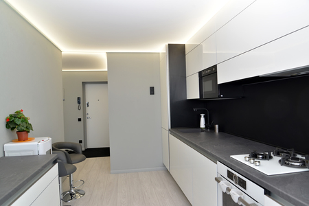 Interior of modern kitchen in gray-black tones