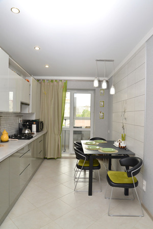 Interior of modern kitchen with a stretch ceiling