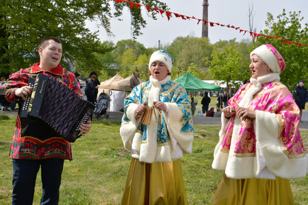 KALININGRAD, RUSSIA - MAY 09, 2019: The trio of the Russian national folklore ensemble acts during the holiday in the park Editorial