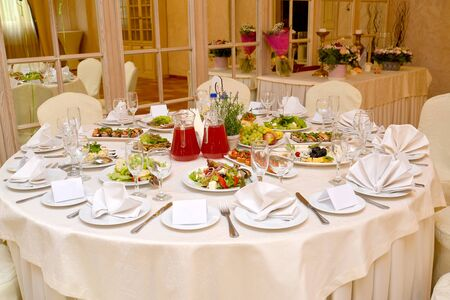 The round table served for a banquet. Restaurant