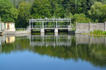 The dam of the Ozerskaya hydroelectric station on the Angrap River. Ozersk, Kaliningrad region Banco de Imagens