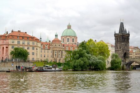 PRAGUE, CZECH REPUBLIC - MAY 28, 2014: A city landscape with the Bridge tower on the bank of the river of Vltava