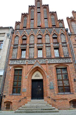 Nicholas Copernicus House (15th century). Torun, Poland. Polish text